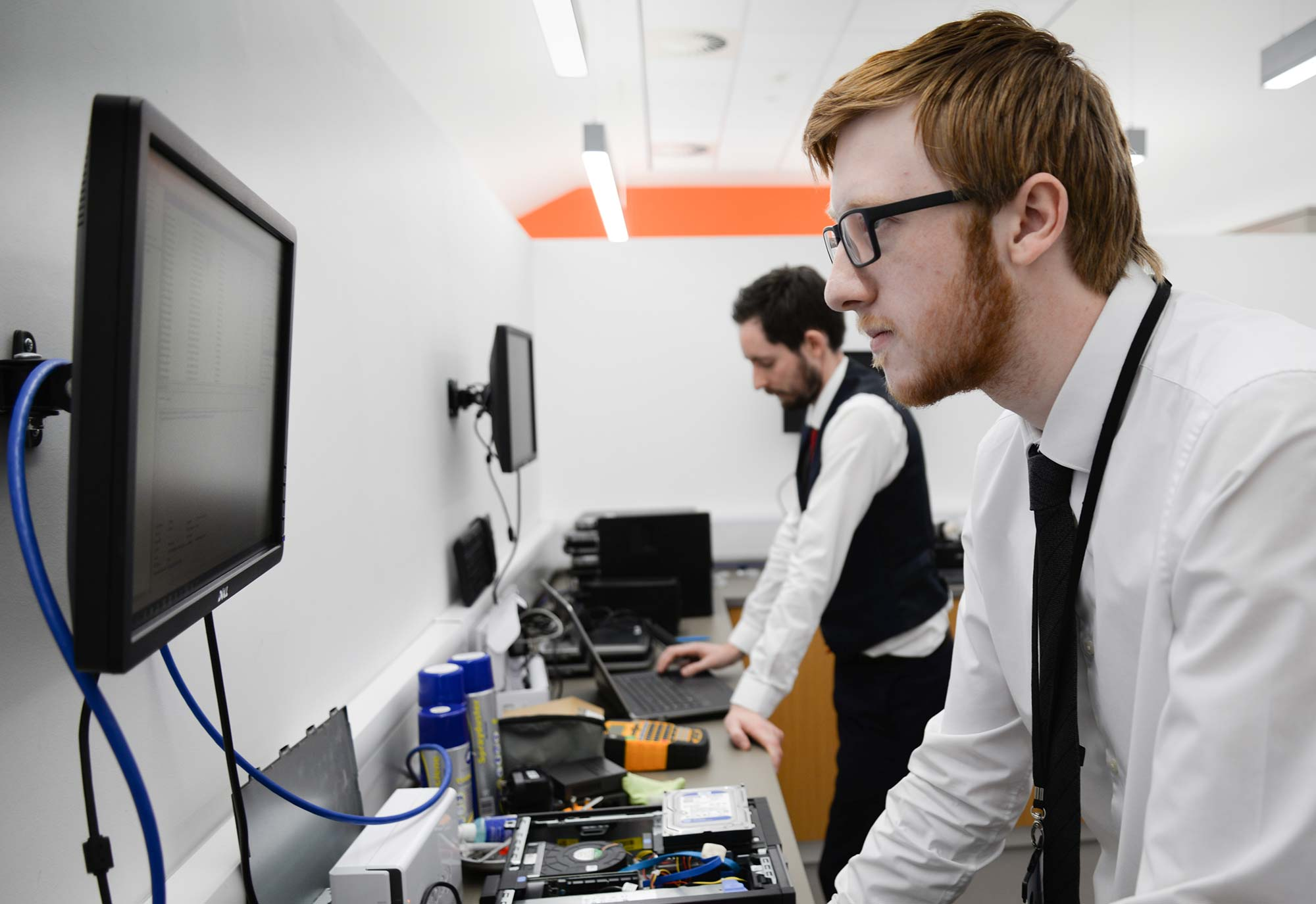 two male members of IT support staff working at Greaves West and Ayre Office