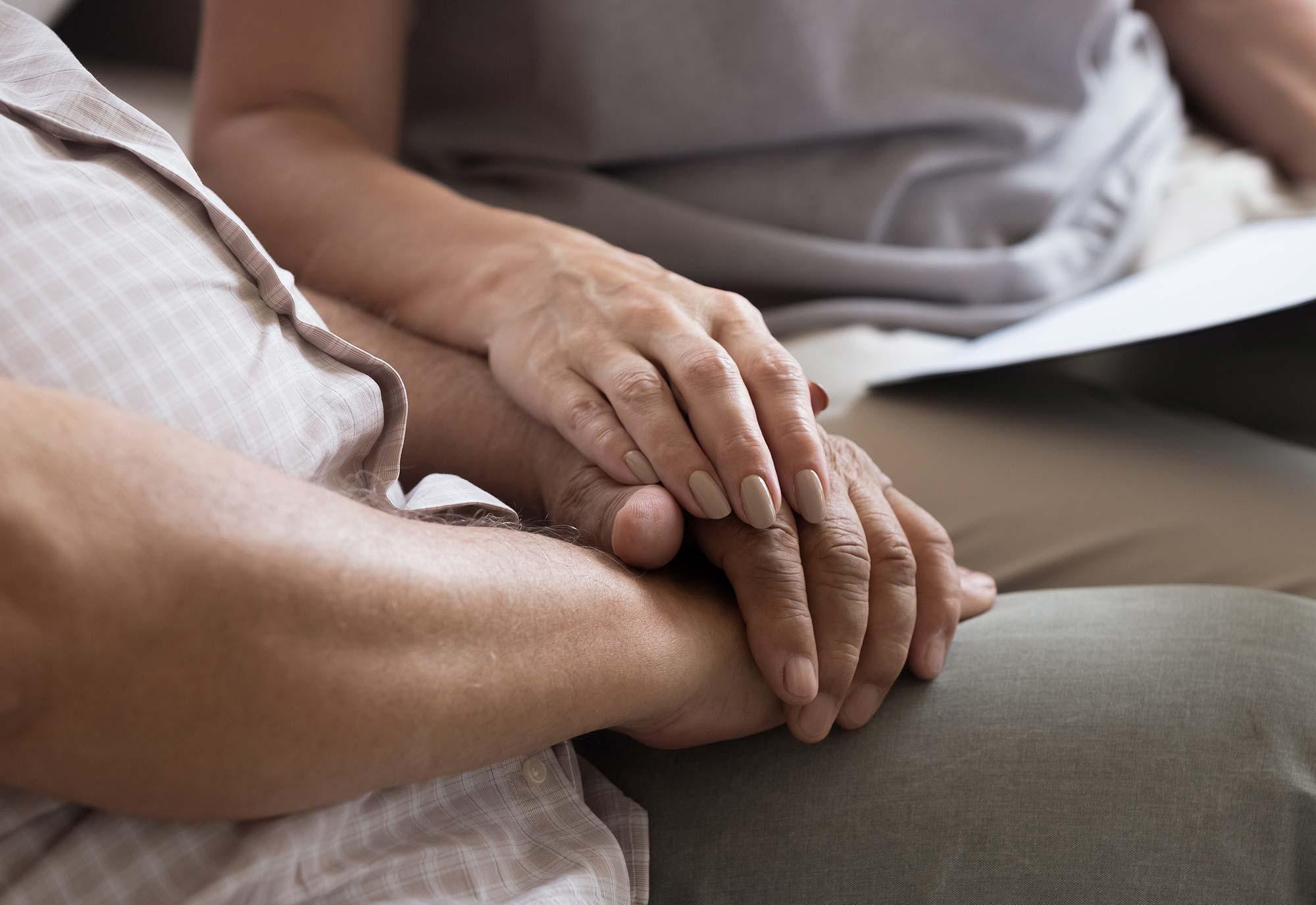 older couple holiding hands