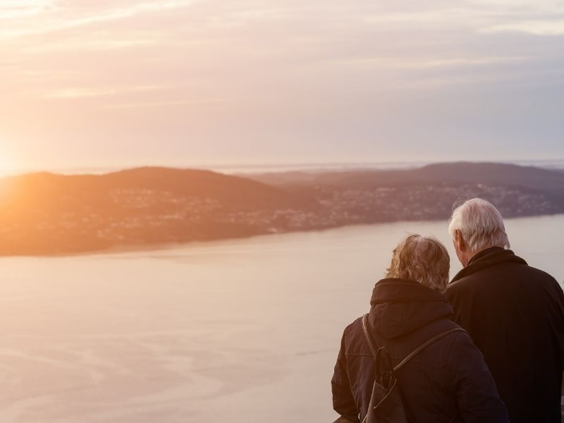 Elderly couple looking at the sunset
