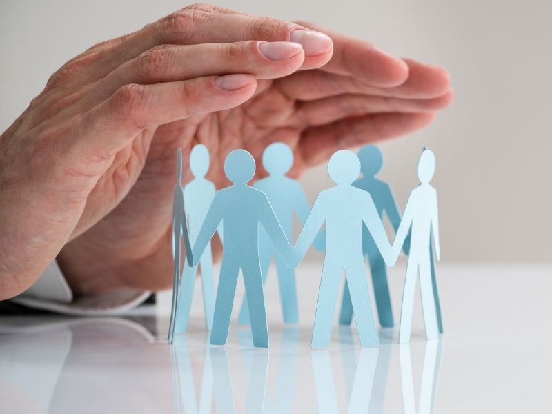 Hands protecting family or employees